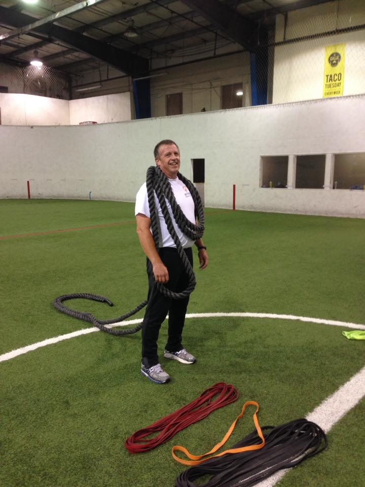 Over 35 getting in shape with ropes and bands at boot camp
